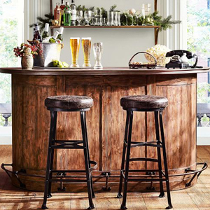Wooden bar with open and closed storage and foot rail at the bottom. photo