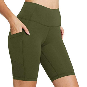 Woman wearing army green bike shorts with pockets. photo