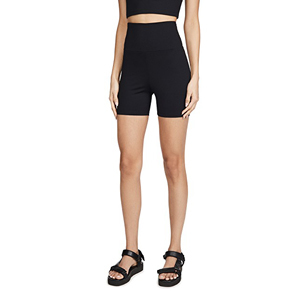 Woman wearing black mid thigh bike shorts from Revolve photo