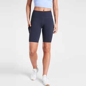 Woman wearing blue bike shorts with pockets from Athleta photo