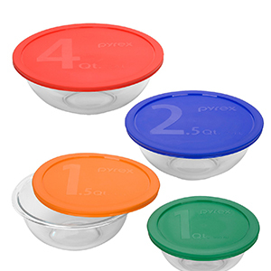 Four glass mixing bowls with red, blue, orange, green lids that are labeled 1,2,3,4. photo