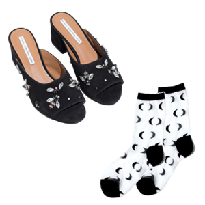 <strong></strong>Black heel mules with gem appliques next to white-and-black socks with crescent moons photo