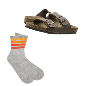 Brown Birkenstock sandals with gray tube socks that have orange ombre stripes on the top photo