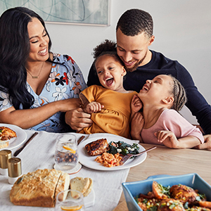 Ayesha Curry and their family at the dinner table. photo