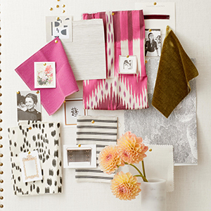 A white wall filled with patterned decor and bright colors. photo