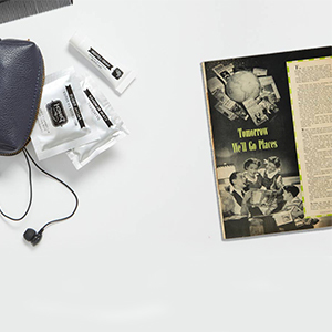 An old black and white magazine sitting on a table. photo