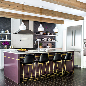 A modern kitchen with purple accents, black and gold chairs, and white walls. photo