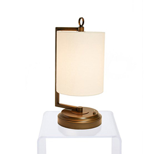 Bronze table lamp with white linen lampshade photo