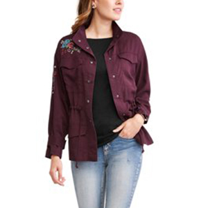 Burgundy utility jacket with embroidered flowers on the right shoulder and upper arm. photo