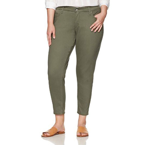 Woman wearing plus-size olive ankle-length jeans. photo