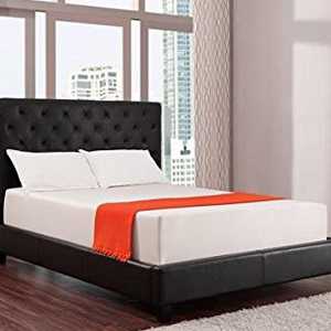 Amazon mattress on a black upholstered bed frame. photo