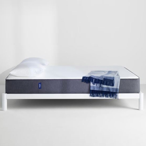 Nordstrom mattress on a white bed frame. photo