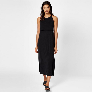 Woman wearing a black maxi dress and black sandals. photo