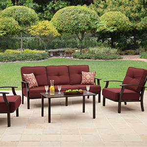 Maroon four-piece outdoor conversation set shown in a backyard. photo