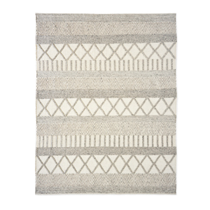 Neutral wool rug with Aztec design. photo
