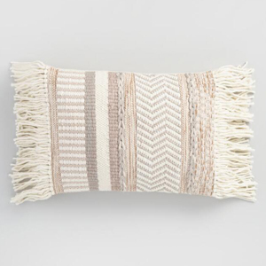 Neutral stripe fringed lumbar pillow. photo