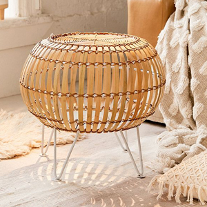 Round ottoman made from rattan. photo