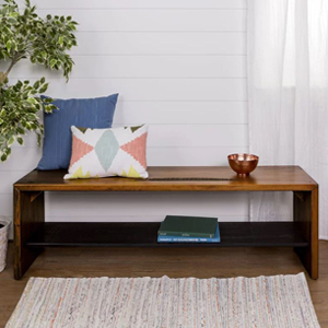 Storage bench made from dark, reclaimed wood. photo