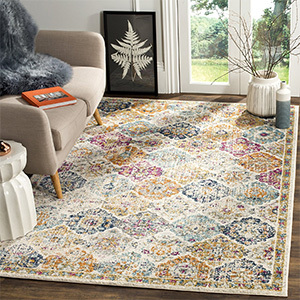 Bohemian-style area rug with blue, mustard yellow, and fuschia colors photo