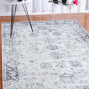 Vintage-style gray and white area rug photo