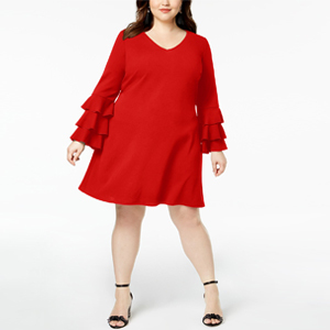 Woman wearing a red plus-size dress with tiered sleeves. photo