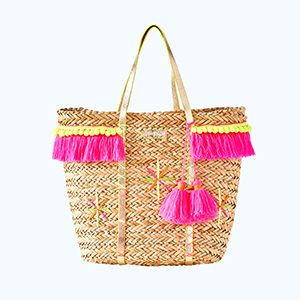 Rattan Lilly Pulitzer tote with pink fringe along on the top and pink tassels on the side photo