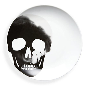 White salad plate with a skull print. photo