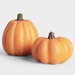 One small and one large lit pumpkin candles photo
