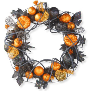 Wreath with gold, orange, and black decorations on it photo