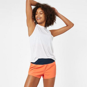 A woman wearing orange and navy workout shorts. photo