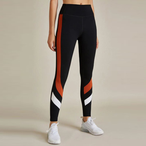 Black leggings with orange and white stripes on the side. photo