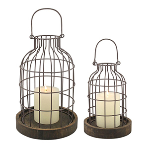 Two cage-style cloches with candles photo
