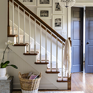 Staircase with a gallery wall and chandelier. photo
