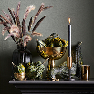 Gourds in gold-colored bowl. photo