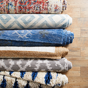Rolled up rugs on a wood floor photo