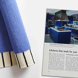 Photo of a cobalt blue rug and page from a vintage magazine article. photo
