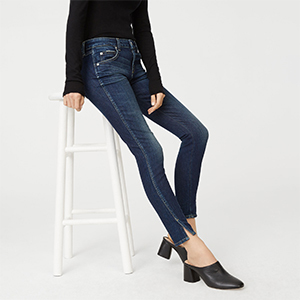Woman wearing Club Monaco jeans in a dark wash with wrap-around side seam photo