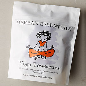 Yoga mat cleansing towelettes in a white package photo