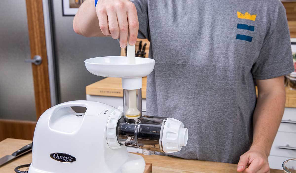 BestReviews staff using a masticating juicer photo