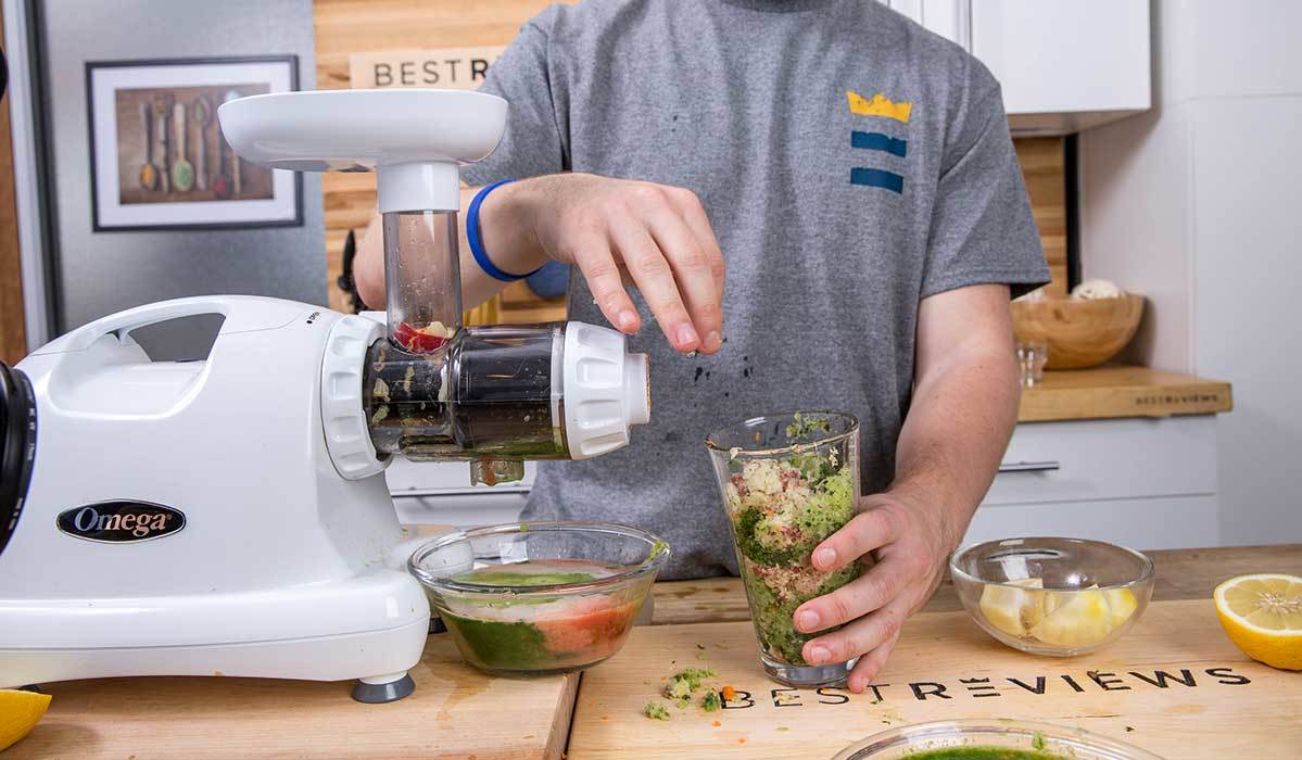 BestReviews testing leafy greens with the Omega masticating juicer photo
