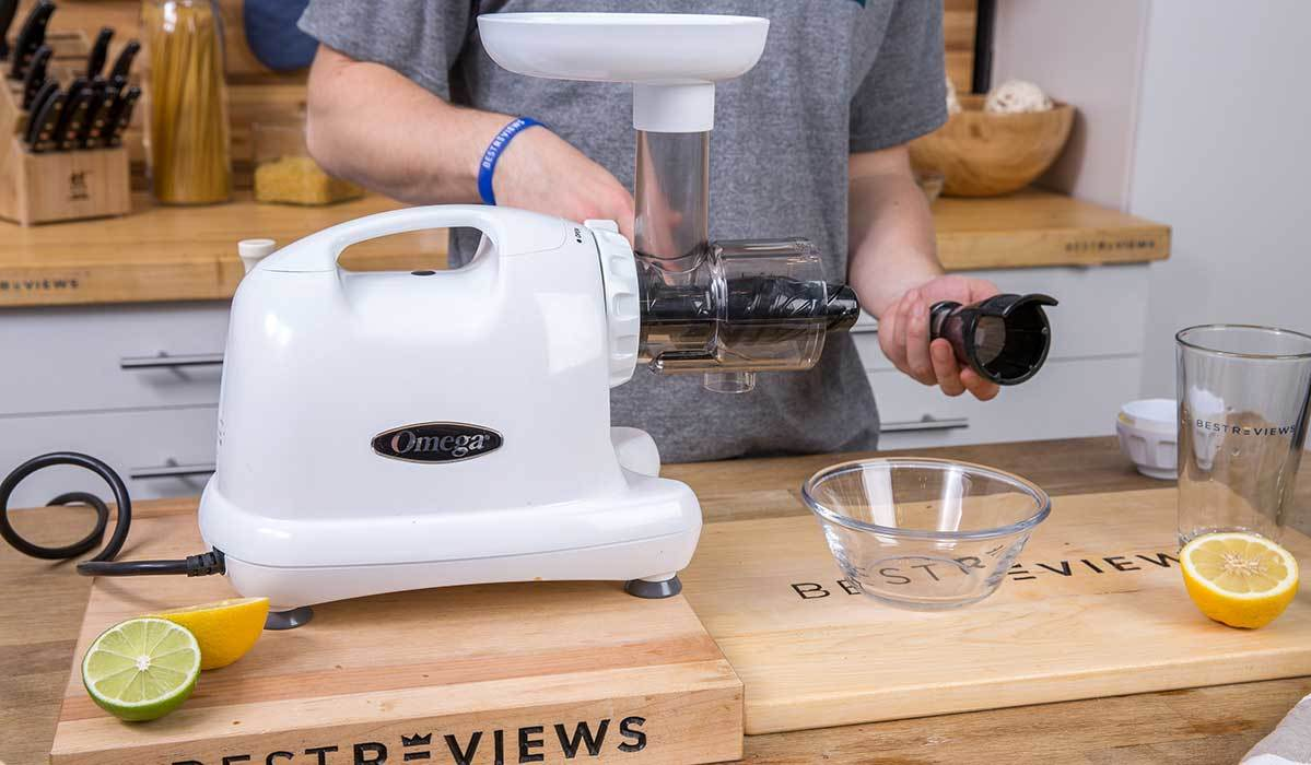 BestReviews staff cleaning a masticating juicer photo