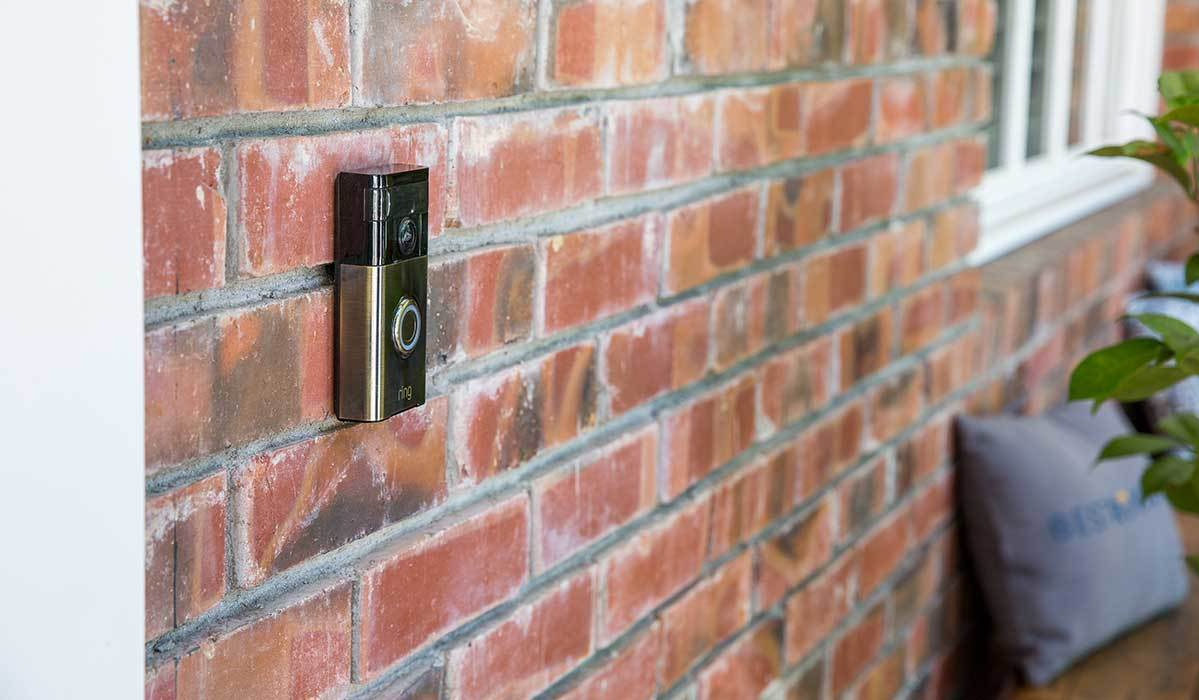 Video doorbell on a brick exterior photo