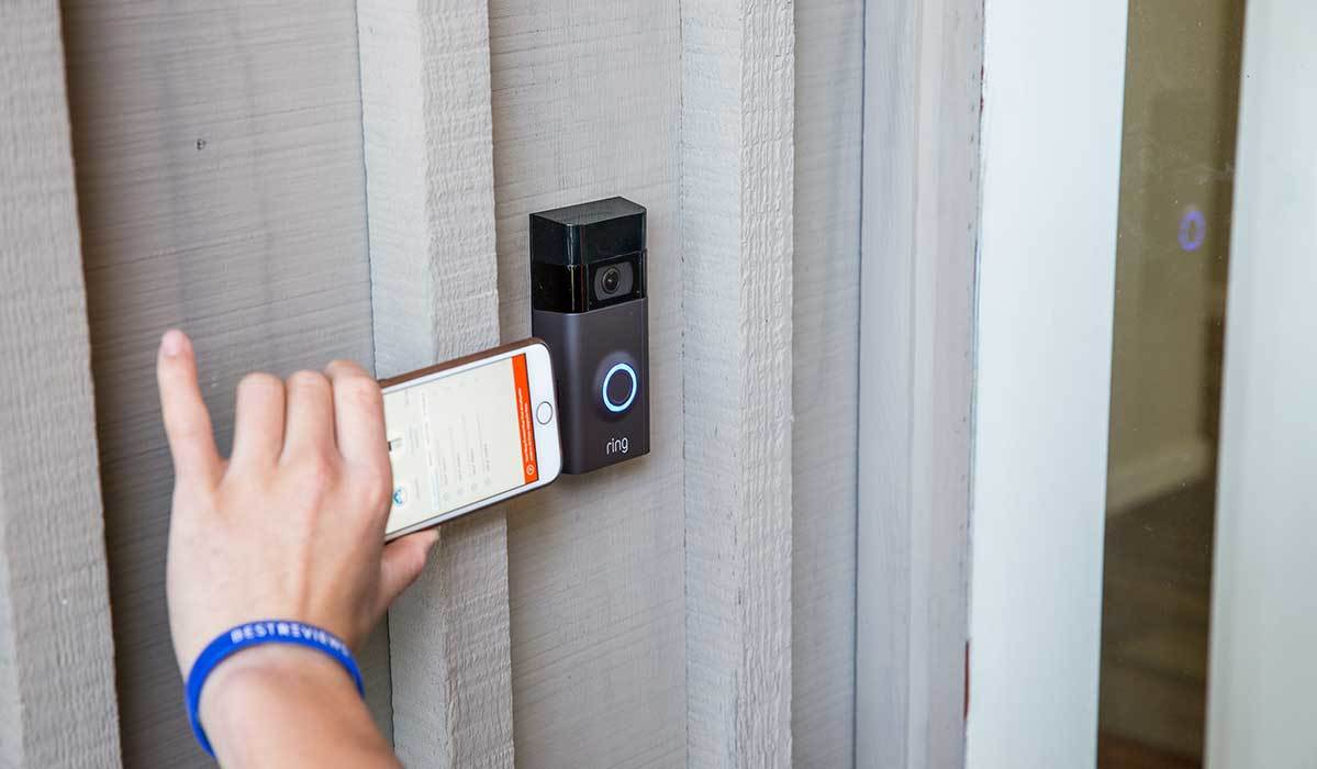 BestReviews comparing Ring video doorbell to size of smartphone photo