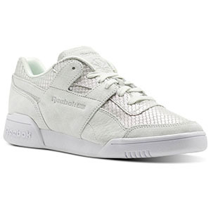 White lace-up sneaker. photo