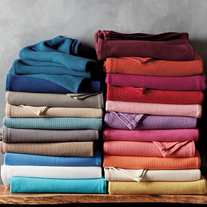 The Home Depot cotton blanket in several colors including blue, tan, white, red, purple, orange, and yellow photo