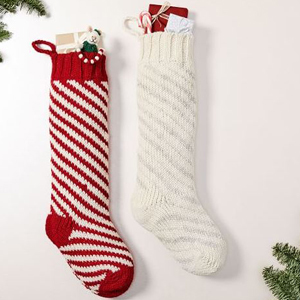 Two holiday stockings including a red and white striped pattern from West Elm. photo