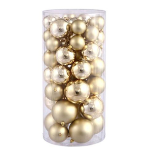 Clear container of gold ornaments from Walmart. photo