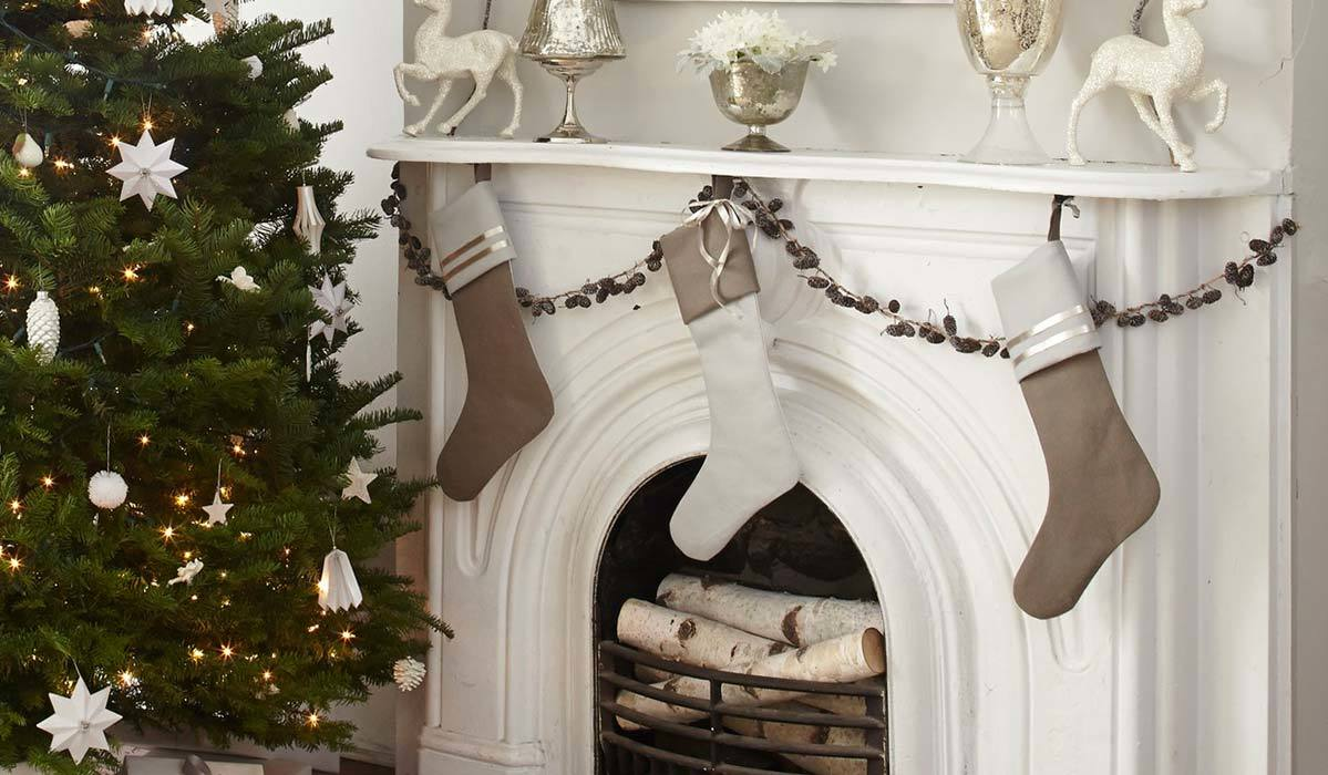 White and gray stockings hung over fireplace