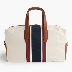 Off-white weekender bag with navy and maroon center stripes. photo