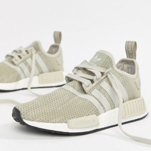 Gray Adidas running shoes with stripes. photo
